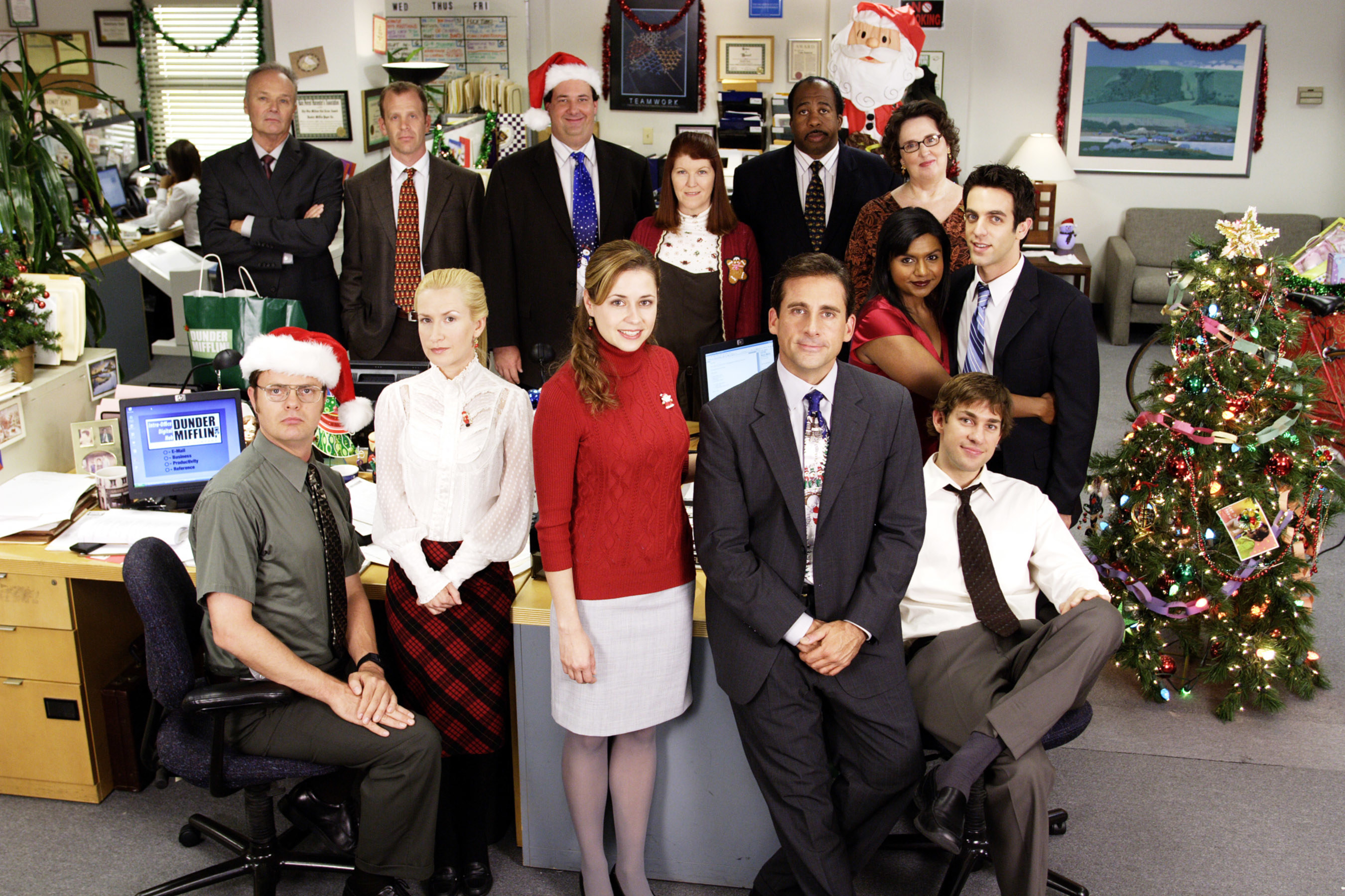 The cast of The Office posing for a christmas card photo