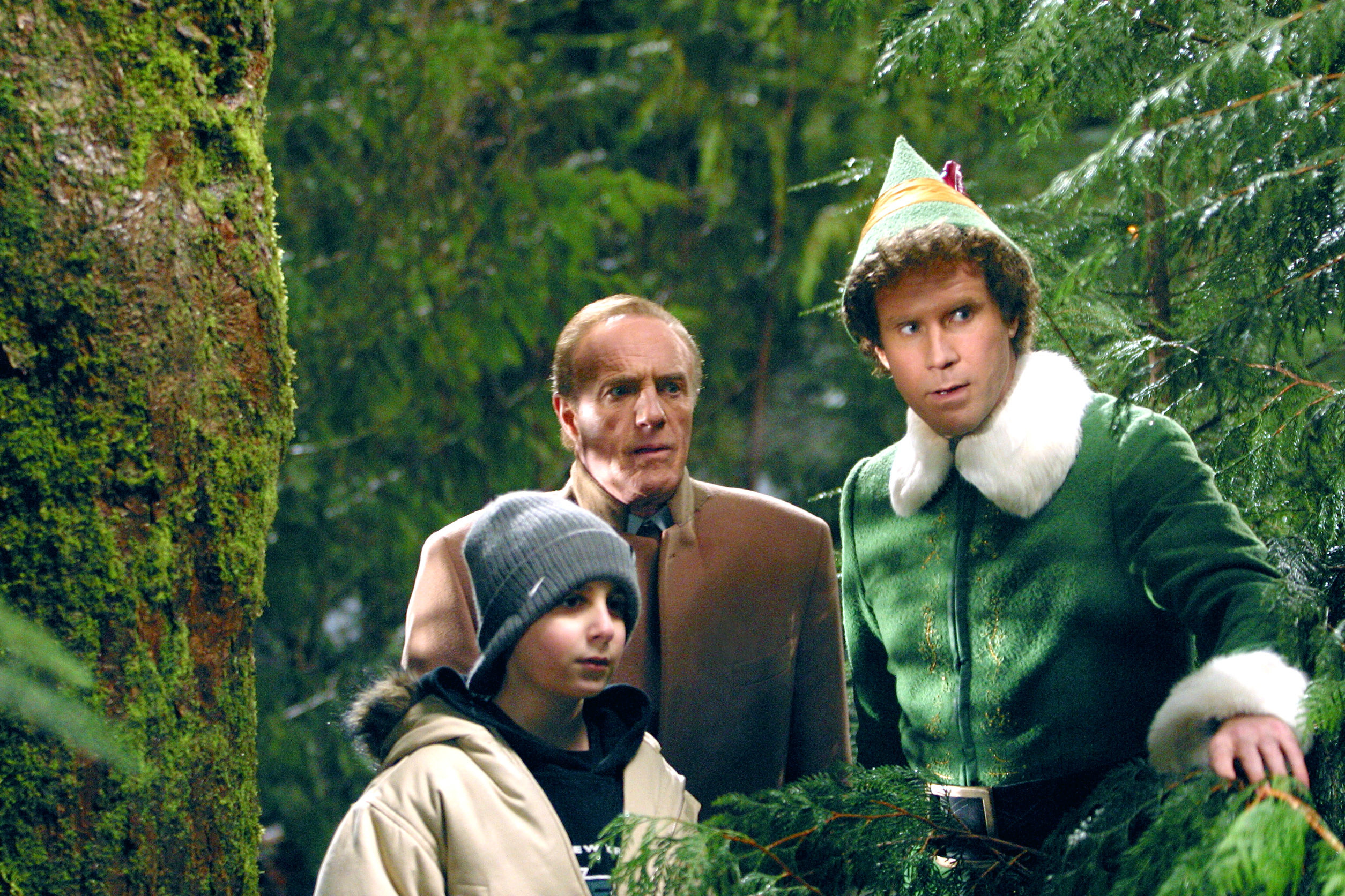 Michael, Walter, and Buddy the Elf in the woods