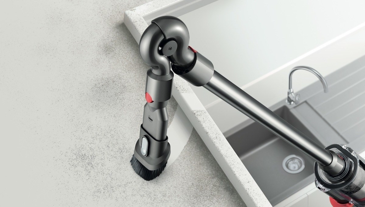 one of the brush attachments being used on the vacuum