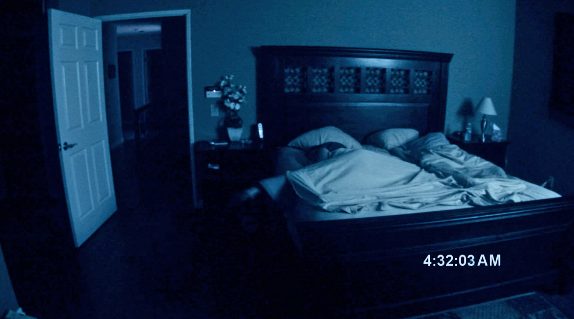 camera filming a couple sleeping