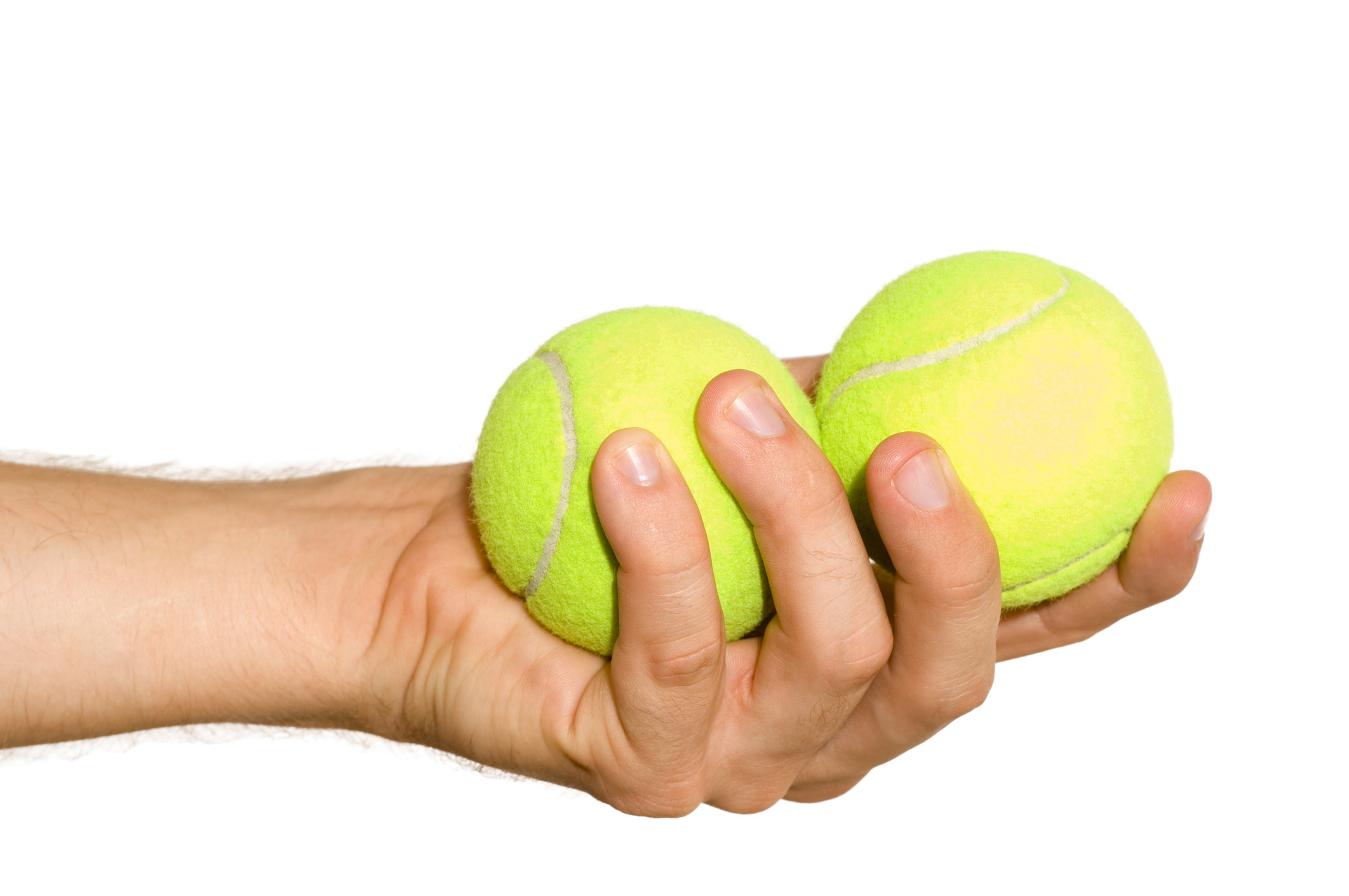 Man holding two tennis balls in his hand