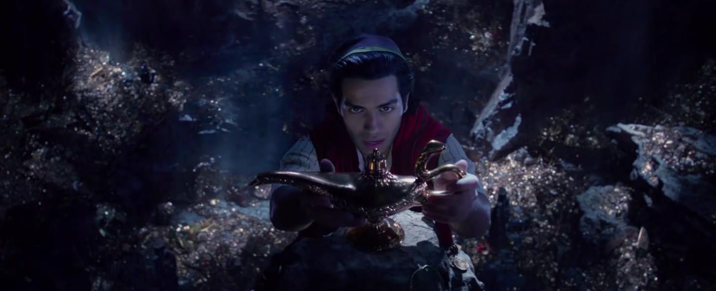Aladdin touching the magic lamp