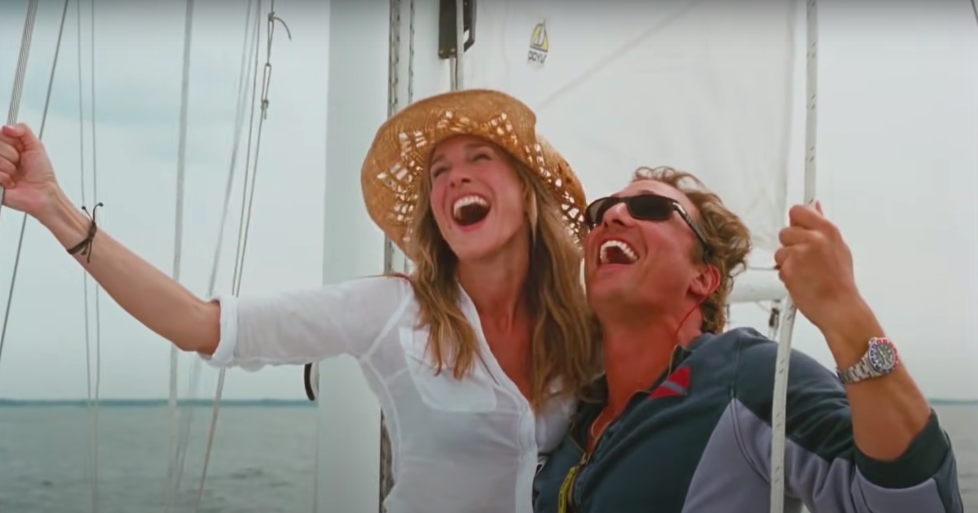 """Paula and Tripp from """"Failure to Launch"""" laughing on a boat"""