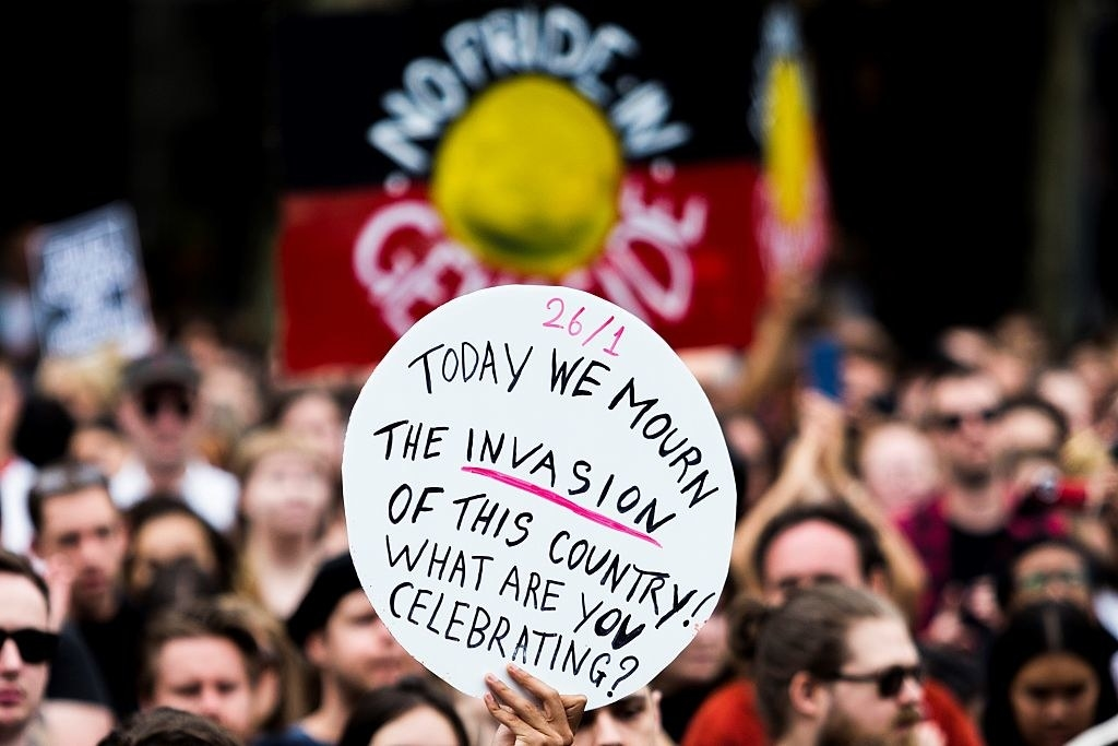 """A sign from a January 26 protest in Australia that reads: """"Today we mourn the invasion of this country! What are you celebrating?"""""""
