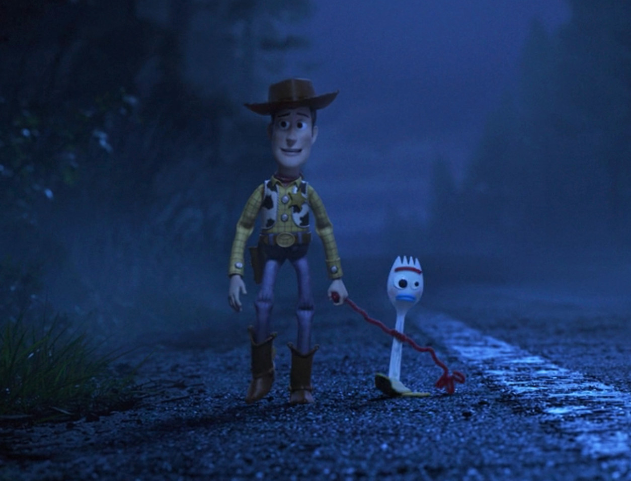 Woody holding Forky's hand as they walk along the side of the street