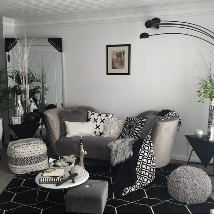 The sofa with throw pillows in a reviewer's home