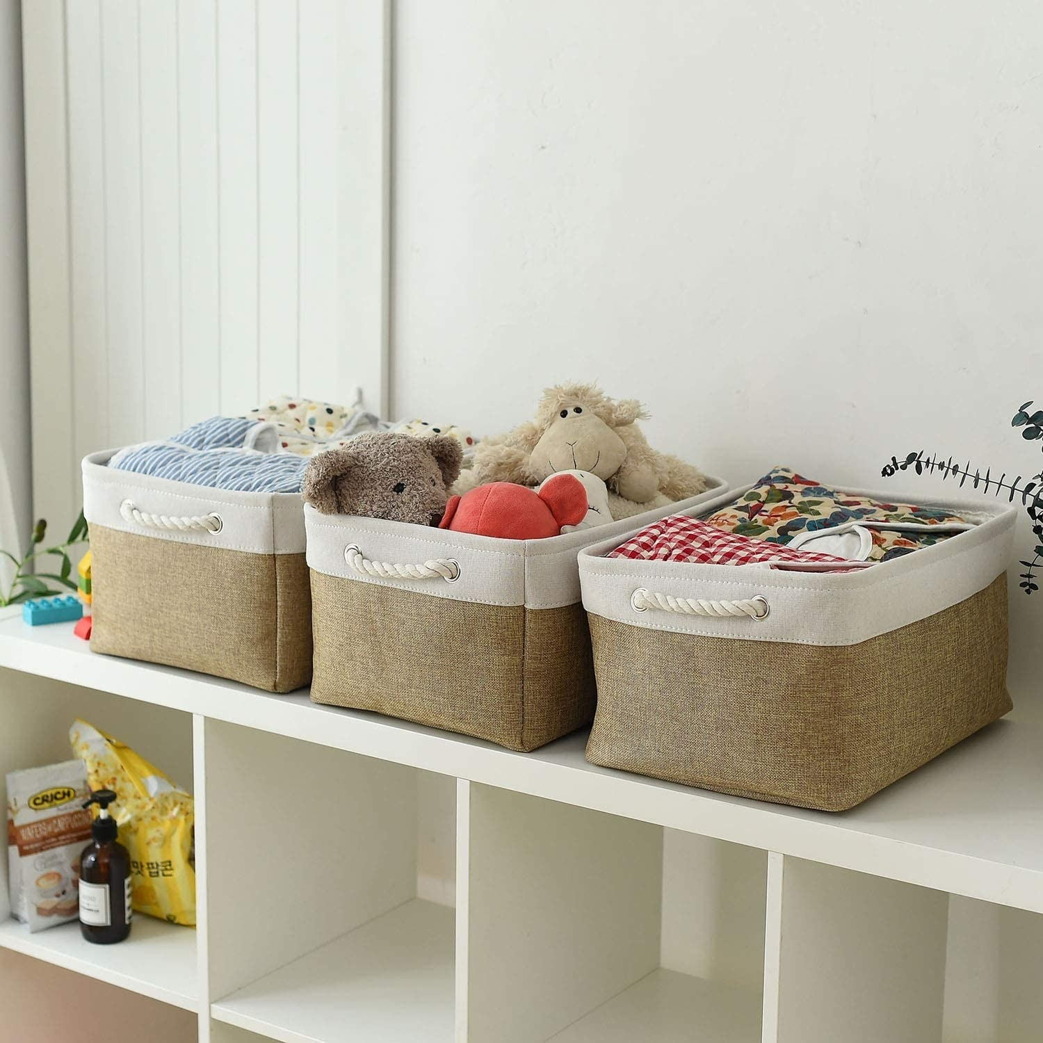 The storage baskets in use filled with baby knick knacks