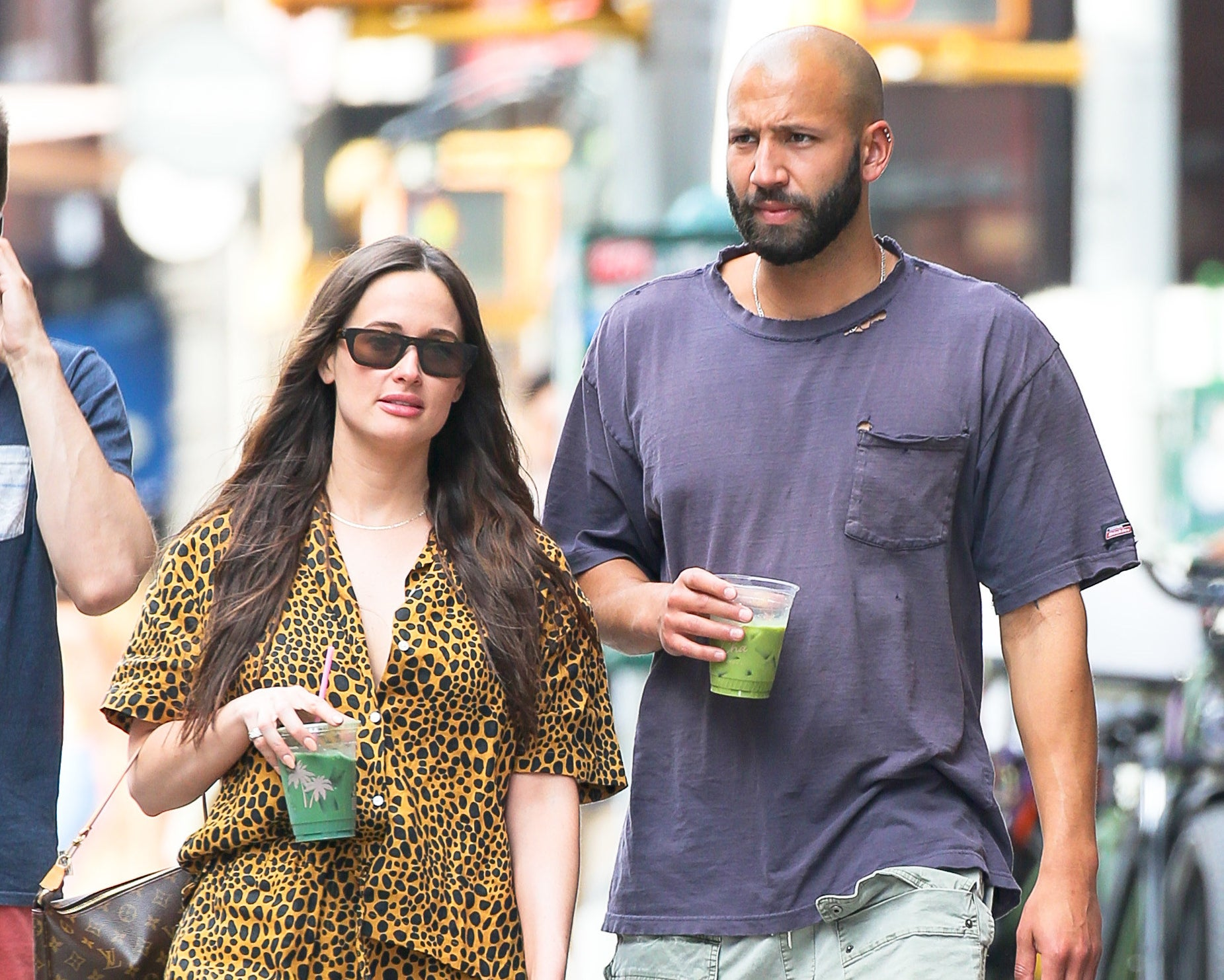 Kacey and Cole walk with drinks in hand on another day in New York