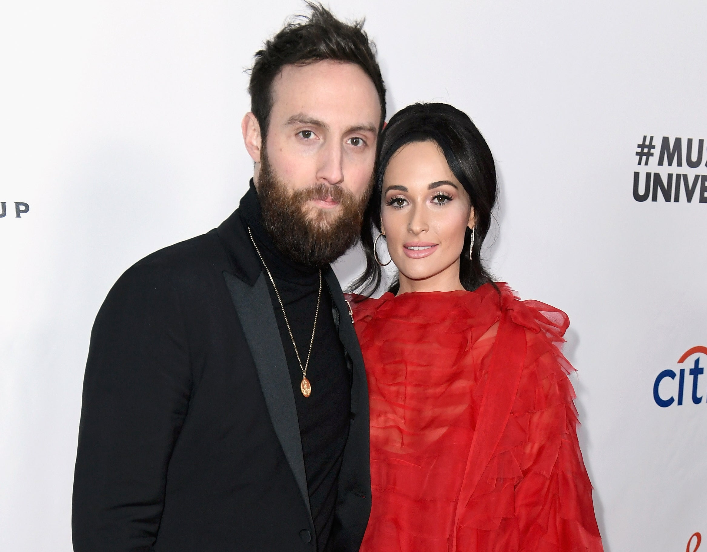Kacey posing with ex Ruston at an event