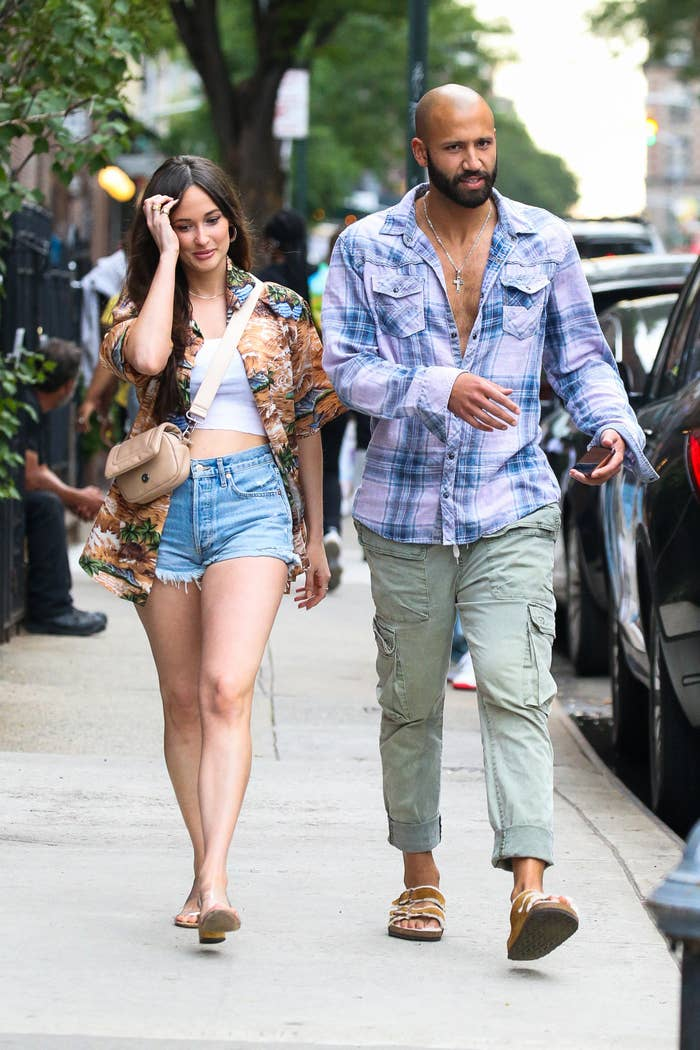 Kacey and Cole walk close together through New York City