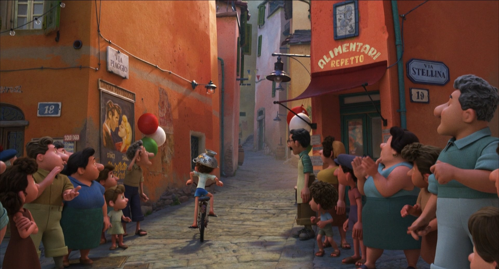 A boy rides a bicycle while townspeople look on.