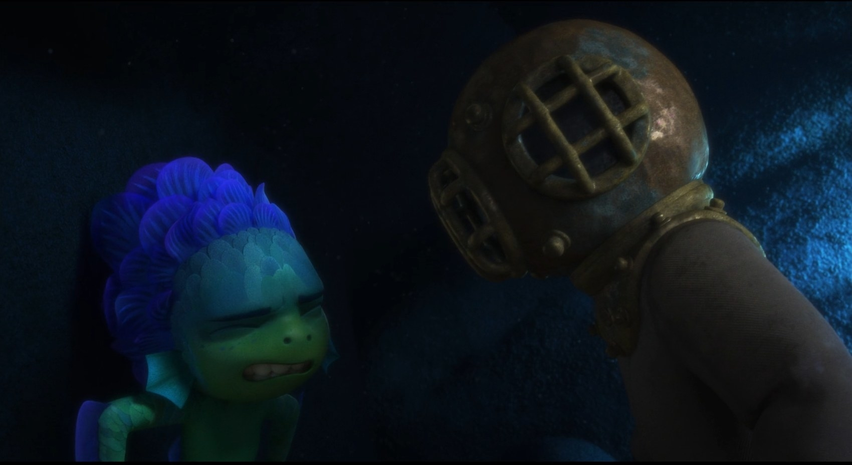 A sea monster is scared in front of someone wearing a full body swimsuit with a helmet