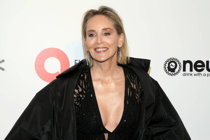 Sharon Stone smiles on the red carpet at annual Elton John AIDS Foundation Academy Awards viewing party.
