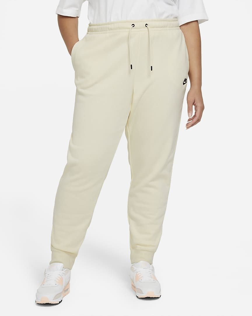 Model wearing cream sweats with a tee shirt and sneakers
