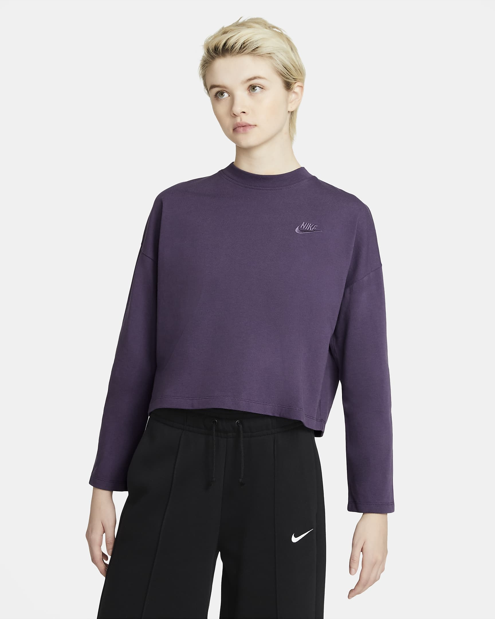 model wearing purple nike crop top
