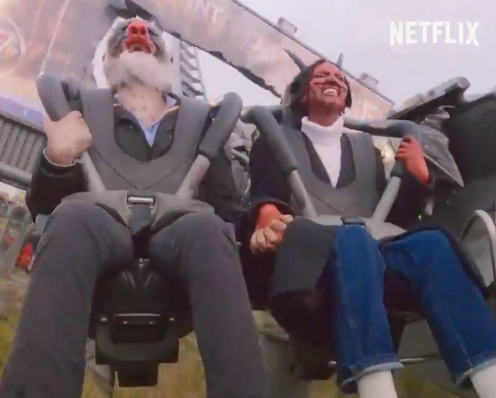 Two people on a roller coaster