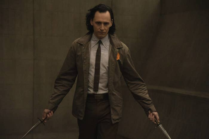 Loki holding his daggers