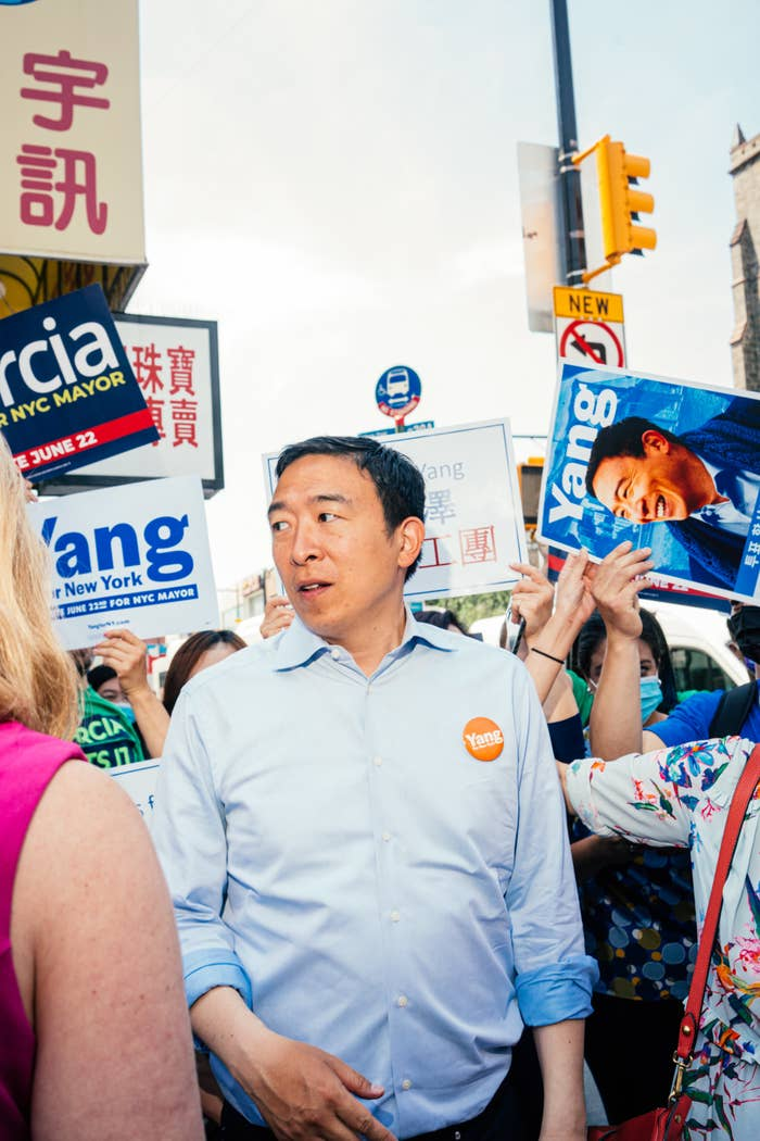 Yang stands amid a crowd of supporters