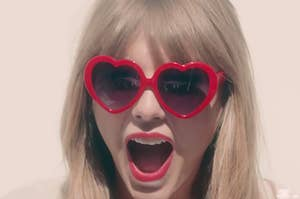 """Taylor Swift wearing heart-shaped sunglasses in the """"22"""" music video"""