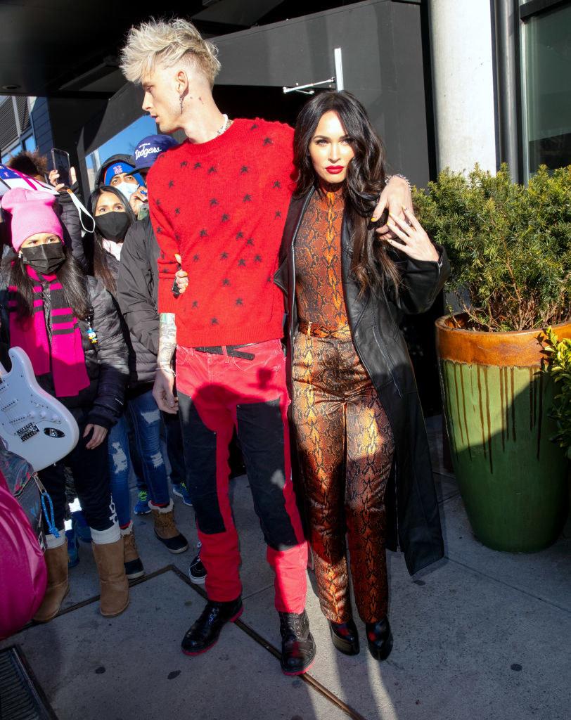 His ladybug sweatshirt and her snakeskin pantsuit