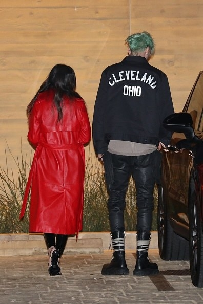 She has a long, bold, red cloak, and he has a Cleveland jacket