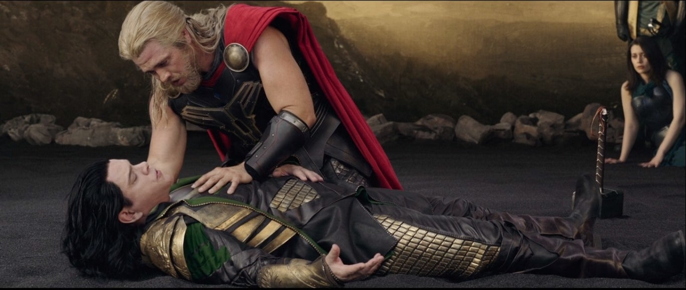 A fake Thor leans over a fake Loki played by Matt Damon