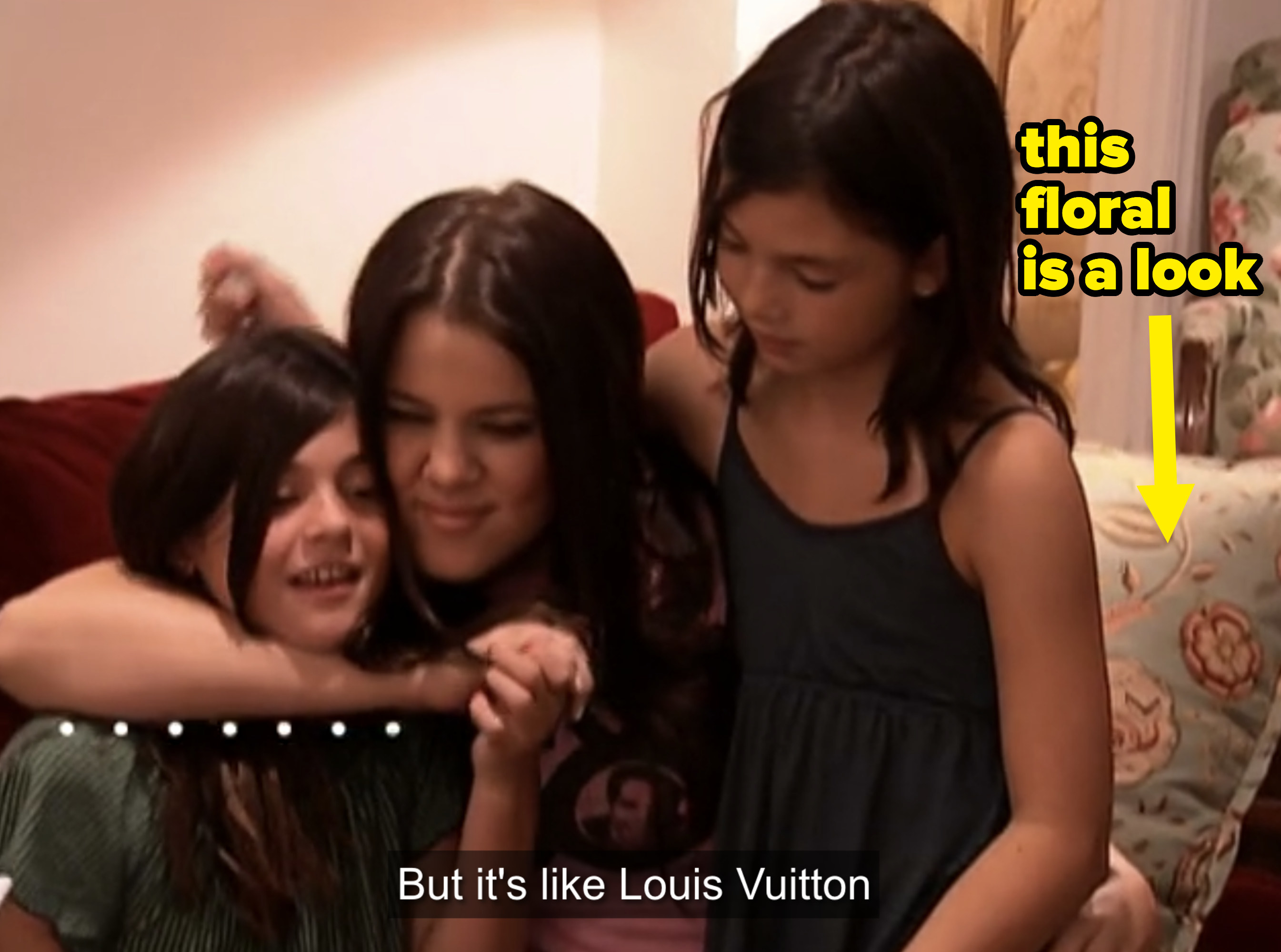Khloe hugging young Kylie and Kendall