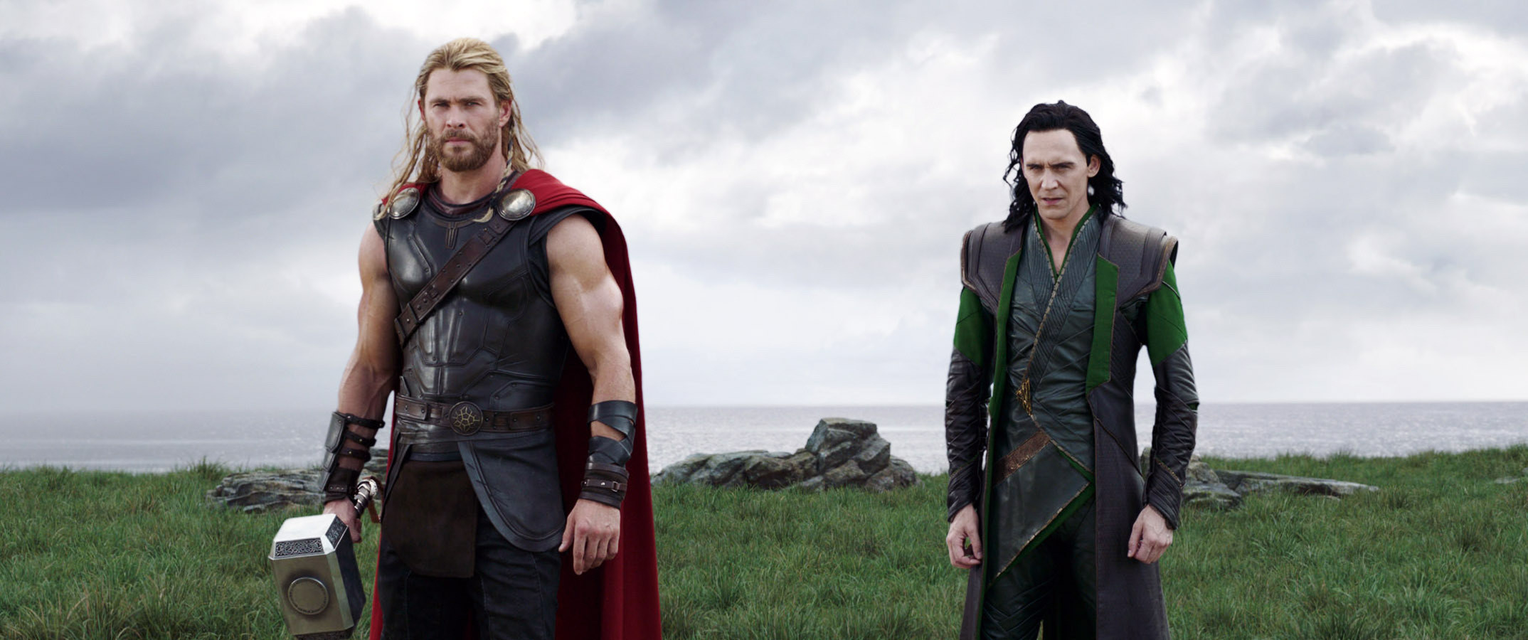 Thor and Loki stand in a field
