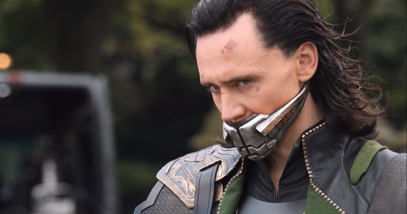 Loki wearing a face mask over his mouth