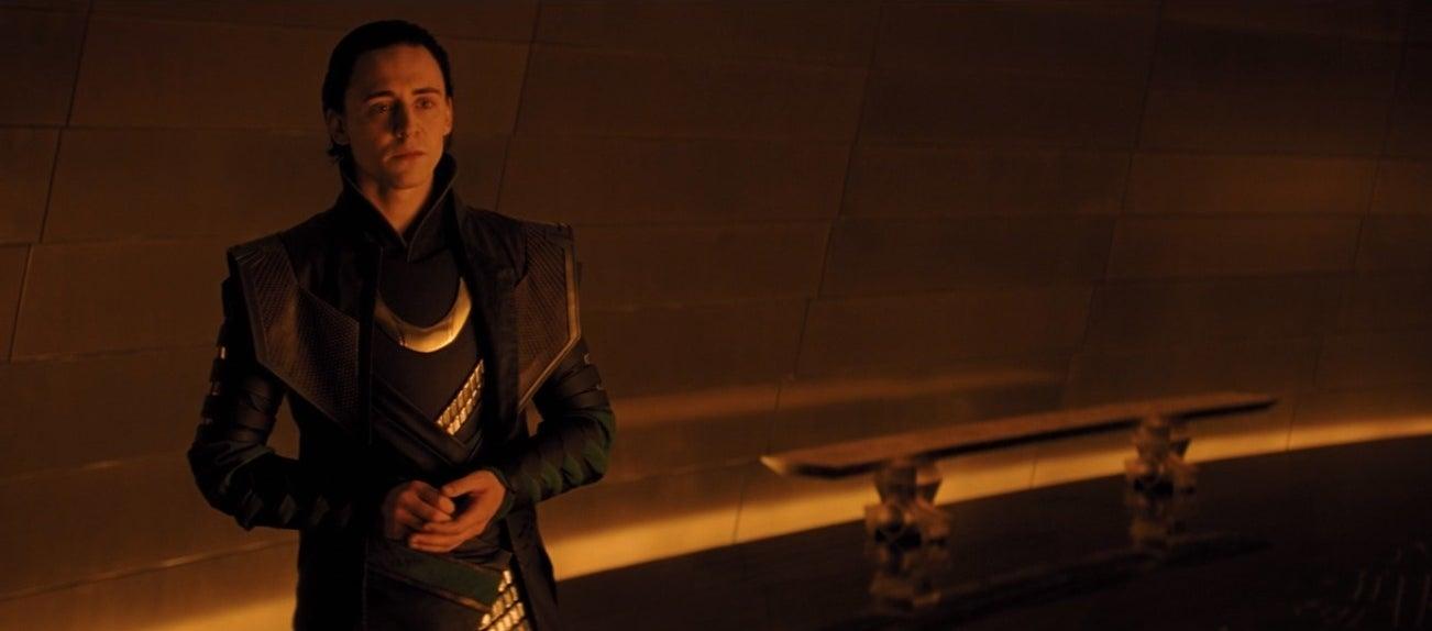 Loki stands near a bench