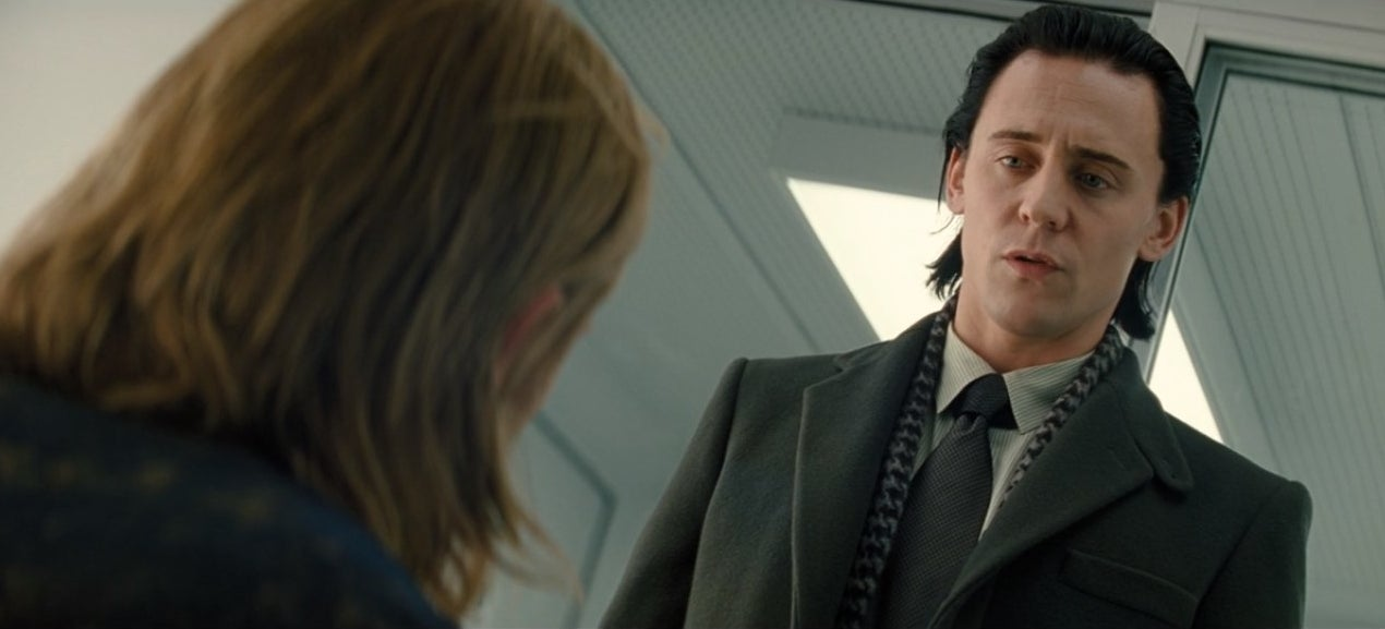 Loki wearing a suit and tie