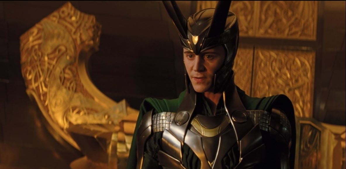 Loki stands before the throne