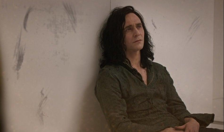 Loki sits forlornly in prison