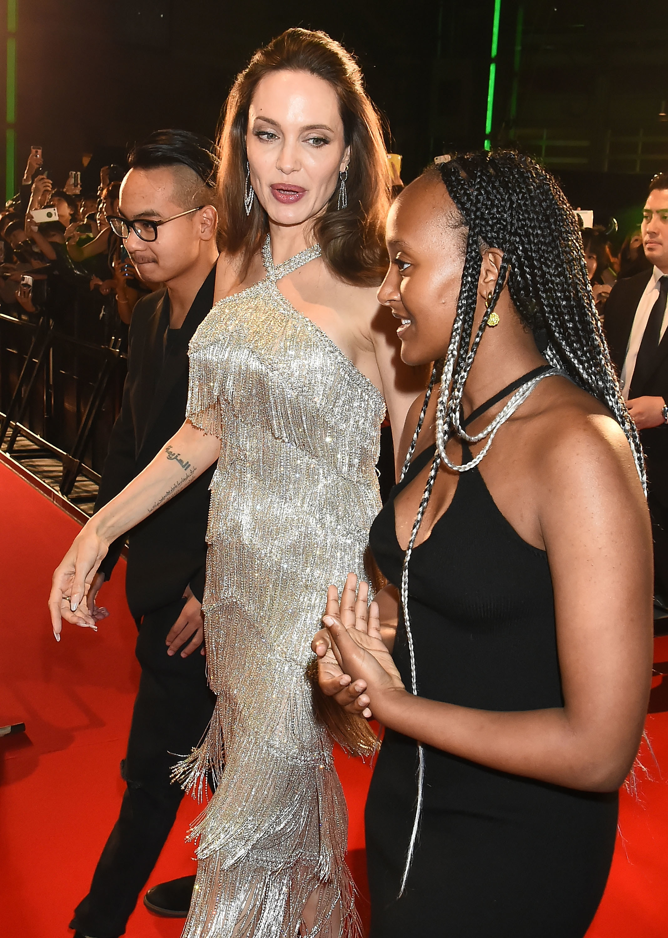 Zahara Marley Jolie-Pitt, Angelina Jolie, and Maddox Jolie-Pitt attend the Japan premiere of 'Maleficent: Mistress of Evil' at Roppongi Hills arena on October 3, 2019, in Tokyo, Japan