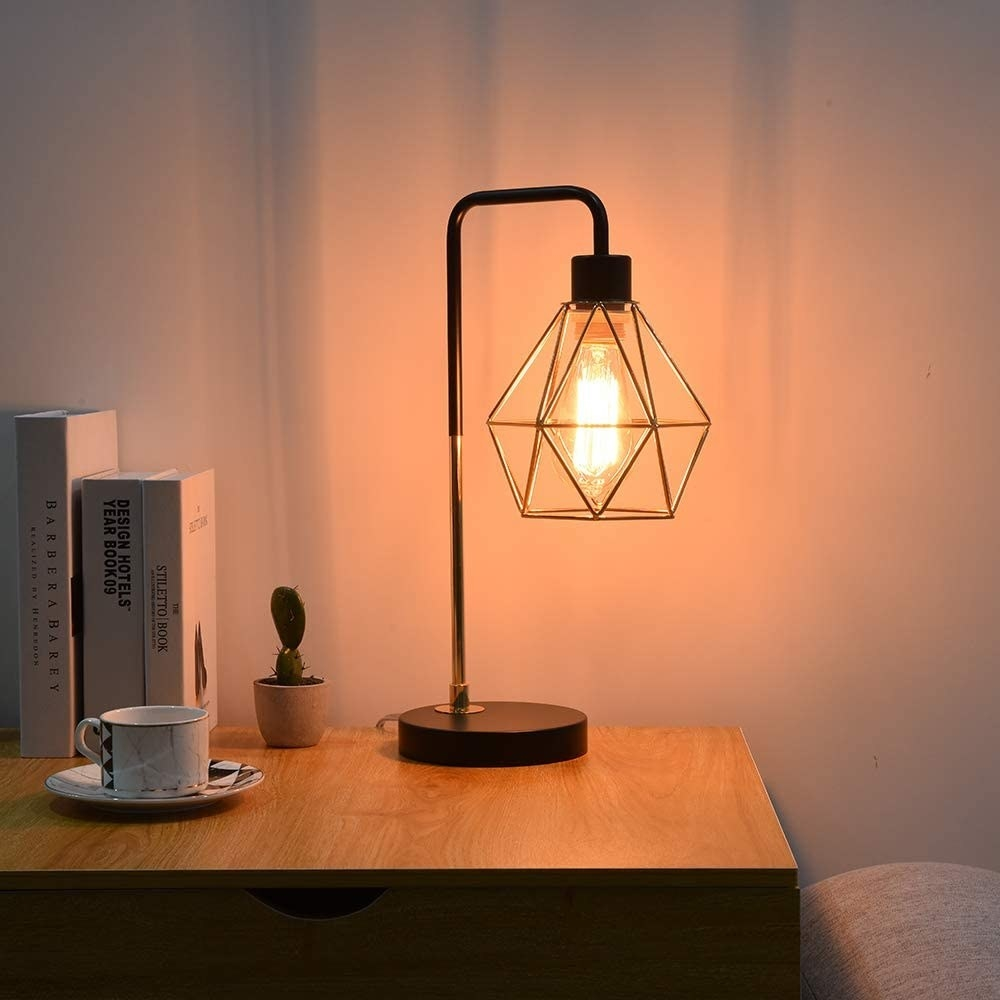 the lamp sits on the wooden side table