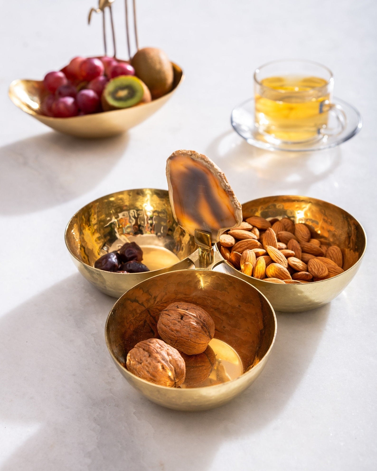 the gold bowl trio with nuts and fruit in each bowl