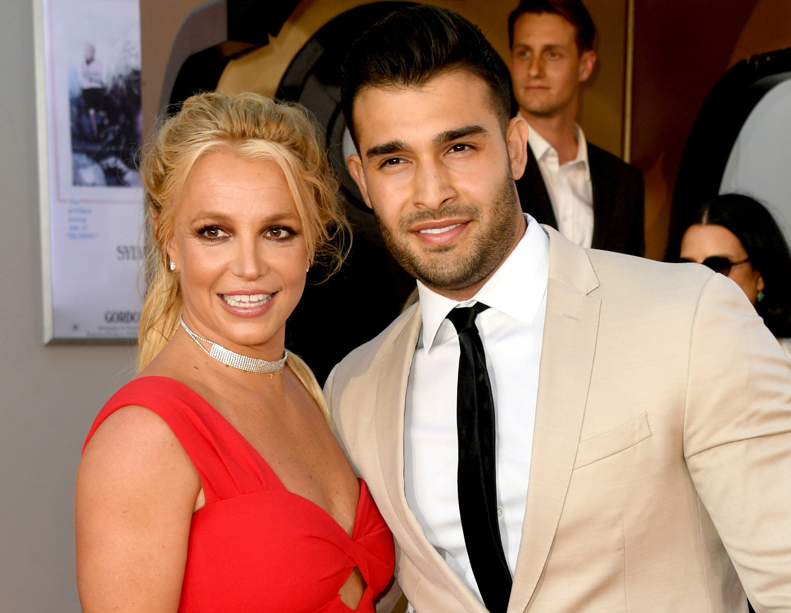 Britney and Sam pose together at an event