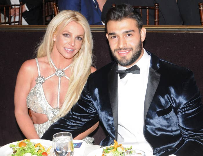 Britney and Sam sit at a table together at an event