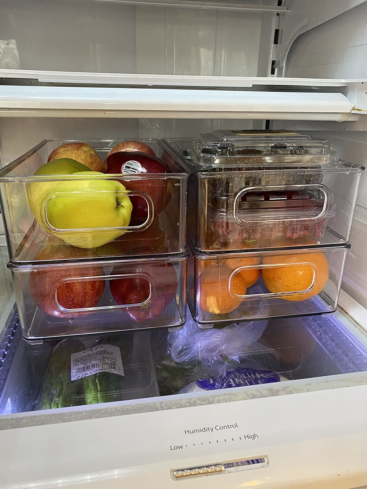 reviewer image of four stackable bins with fruit in them in a fridge