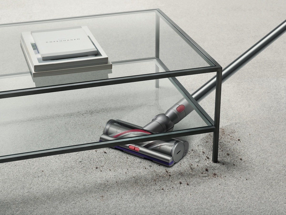 the vacuum cleaning dirt under a glass coffee table