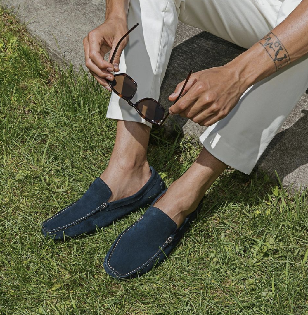 person sitting on the grass with the shoes on
