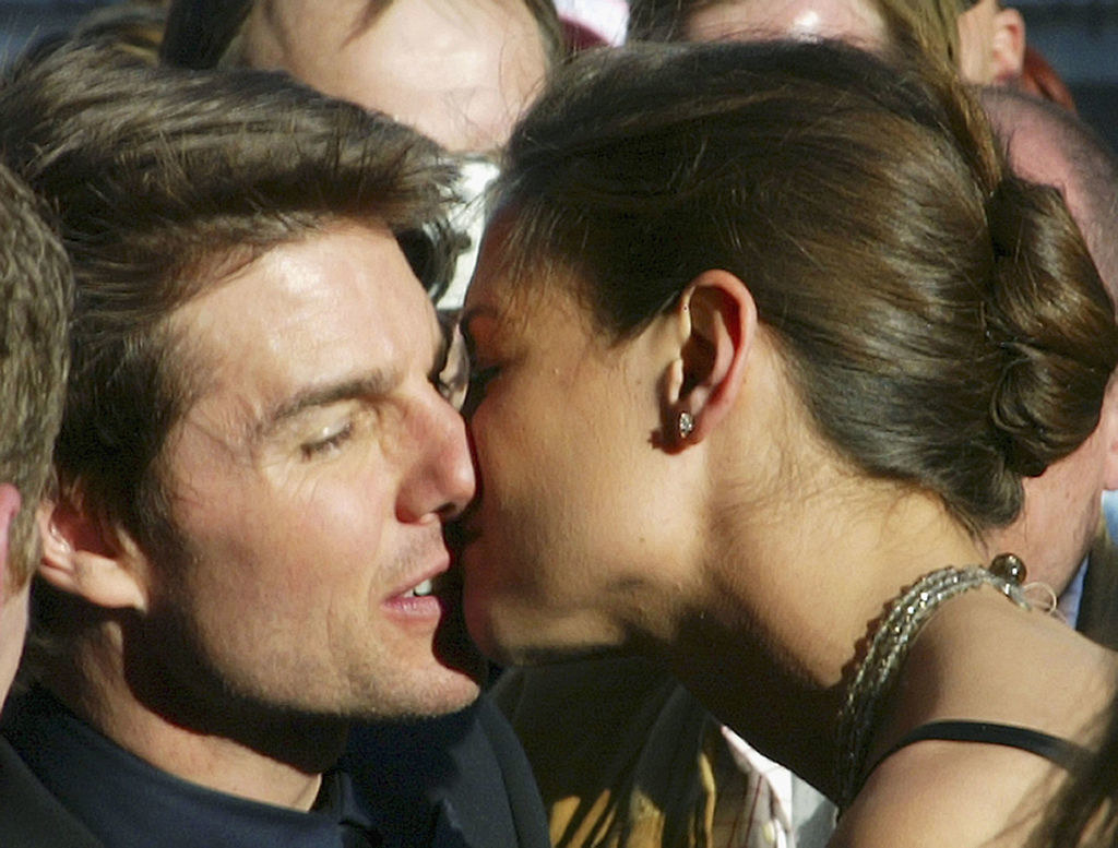 Tom Cruise and Katie Holmes sharing a kiss