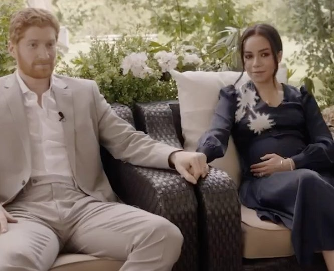 A screenshot from the movie where Meghan and Harry are interviewed