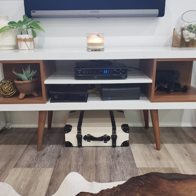 reviewer's photo of the tv stand