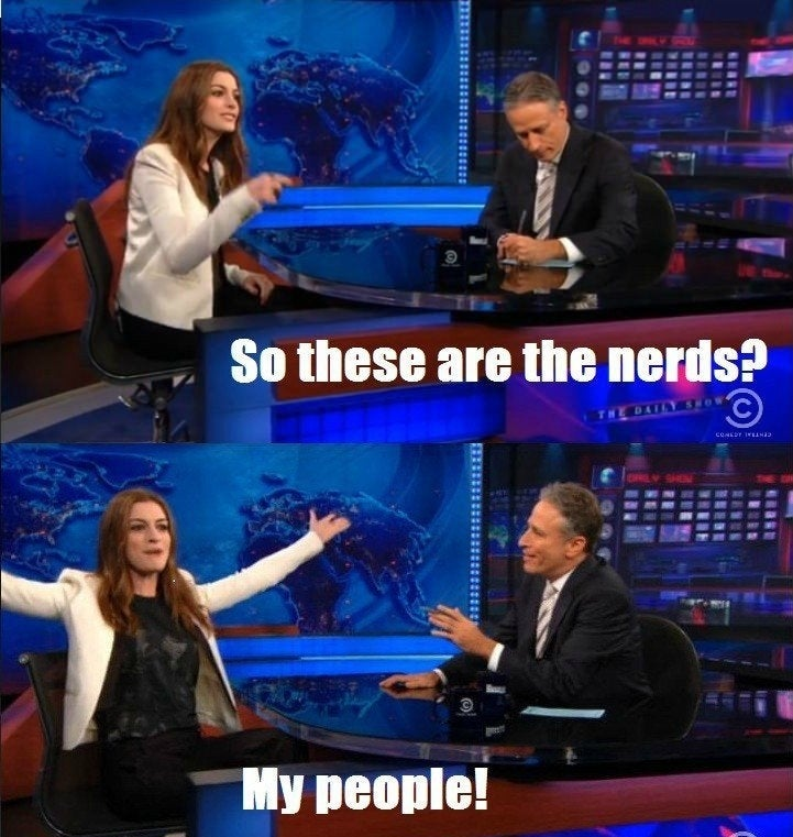 """Anne Hathaway says """"so these are the nerds? my people!"""" then throws her hands up"""