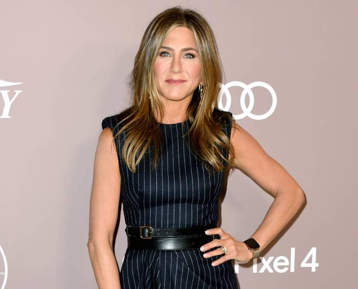 Jennifer wears a pinstripe strapless dress