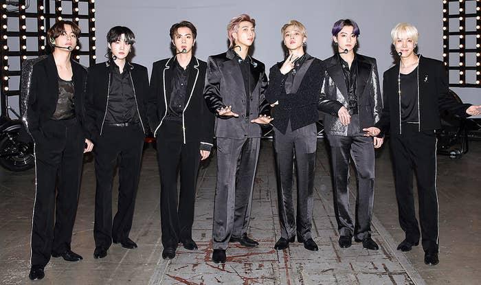 BTS wear dark suits on set for the Billboard Music Awards