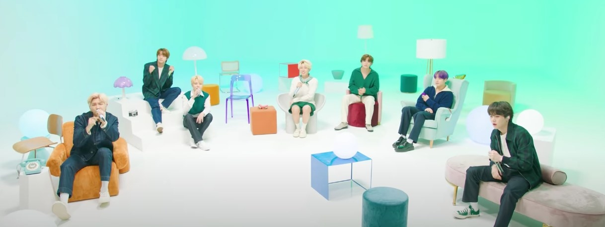 """BTS sit on colorful furniture performing """"Look Here"""""""