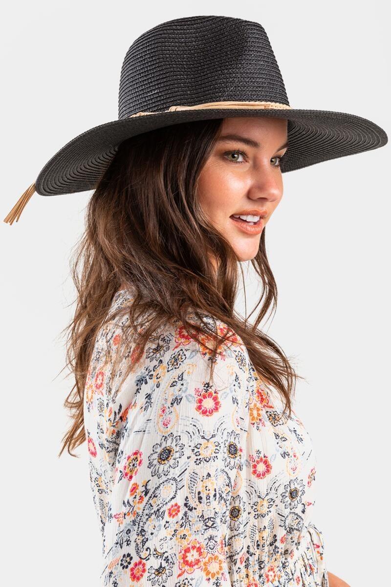 model wearing a black straw panama hat