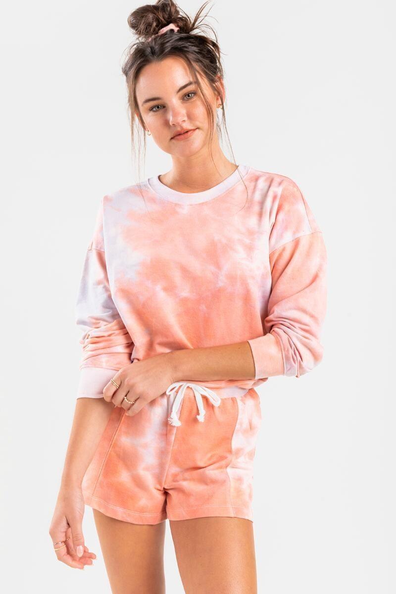 model wearing a pink and orange tie-dye sweatshirt